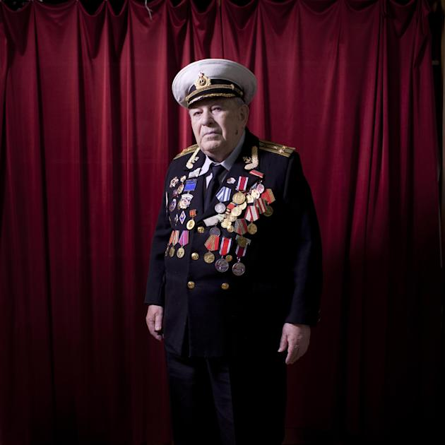 In this photo made Wednesday, April 17, 2013, Soviet Jewish World War Two veteran David Rivelsky poses for a portrait at his house in Jerusalem, Israel. In 1941, he took part in the heroic defense of