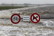 Traffic signs are seen on the North Sea beach near the town of Norddeich, December 5, 2013. REUTERS/Ina Fassbender