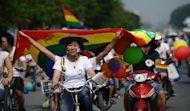 The first gay pride parade in communist Vietnam took place in the capital Hanoi with dozens of cyclists displaying balloons and rainbow flags streaming through the city's streets