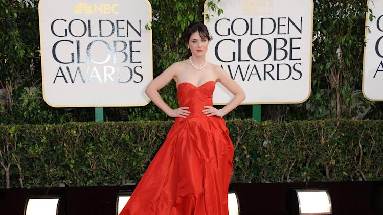 Actress Zooey Deschanel arrives at the 70th Annual Golden Globe Awards at the Beverly Hilton Hotel on Sunday Jan. 13, 2013, in Beverly Hills, Calif. (Photo by Jordan Strauss/Invision/AP)