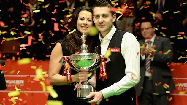 Mark Selby lifts the trophy with wife Vikki after winning the Dafabet World Snooker Championship final at Crucible Theatre on May 5, 2014 in Sheffield, England.