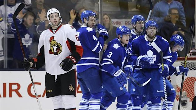 Ottawa Senators Eric Gryba (L) looks on after Toronto Maple Leafs scored a goal during the third period of their NHL hockey game in Toronto February 16, 2013 (Reuters)