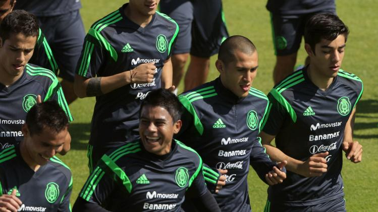 Nilo runs with teammates during a practice session in Mexico City