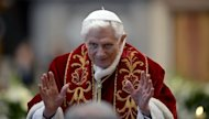 Pope Benedict XVI waves as he leaves the mass at St Peter's Basilica to mark the 900th anniversary of the Order of the Knights of Malta on February 9, 2013 at the Vatican