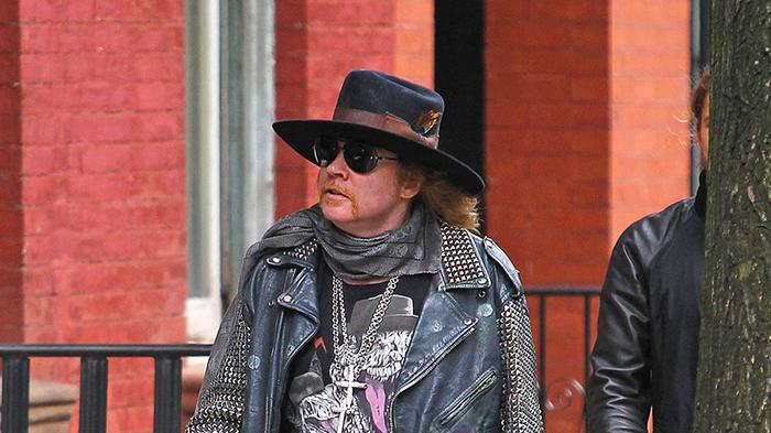Axel Rose, rocking a studded leather jacket and cane, heads out around the West Village with friends in New York City