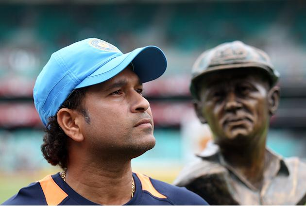 Sachin Tendulkar stands with a statue of Don Bradman