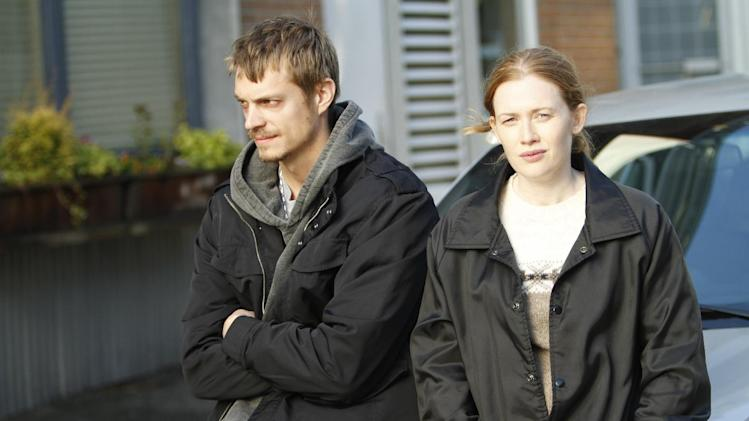 "This image released by AMC showsJoel Kinnaman as Detective Stephen Holder, left, and Mireille Enos as Detective Sarah Linden from ""The Killing,"" returning for a third season on June 2. (AP Photo/AMC, Joel Kinnaman)"