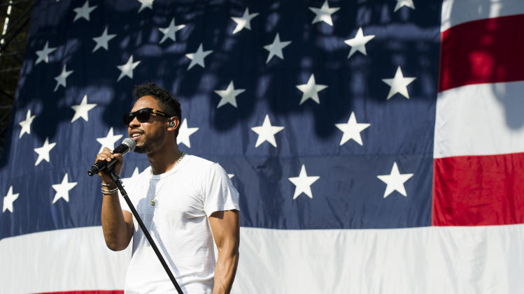 Miguel performs on day two of the 2013 Budweiser Made in America festival on Sunday, Sept. 1, 2013 in Philadelphia. (Photo by Charles Sykes/Invision/AP)