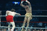 Hector Camacho, right, jumps out of the way of a punch thrown by Ray Mancini during the third round of their WBO Junior Welterweight Title fight in Reno, Nevada, March 7, 1989. Camacho won on a split decision. (AP Photo/Staff/Risberg)