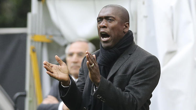 AC Milan coach Clarence Seedorf, of the Netherlands, shouts during the Serie A soccer match between AC Milan and Livorno at the San Siro stadium in Milan, Italy, Saturday, April 19, 2014