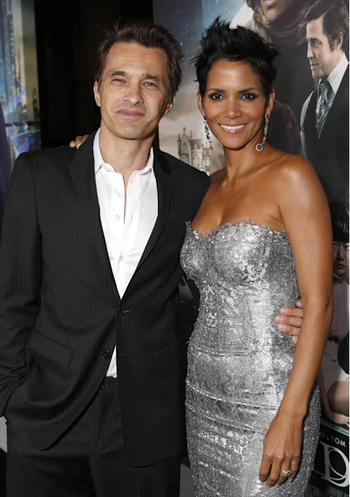 Olivier Martinez and Halle Berry arrive at the Los Angeles premiere of 'Cloud Atlas' at Grauman's Chinese Theatre on October 24, 2012 in Hollywood, California.  (Photo by Todd Williamson/Invision/AP I