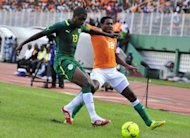 Ivory Coast's Kader Keita (R) fights for the ball with Senegal's Jacques Doudou Faty during the African Cup of Nations qualification match at the Felix Houphouet-Boigny stadium in Abidjan. Ivory Coast won 4-2