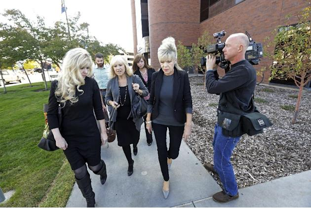 A family members of Michele MacNeill, leave the courthouse following court on Thursday, Oct. 17, 2013, in Provo, Utah. Utah. Martin MacNeill, a former doctor, is charged with murder in the 2007 death