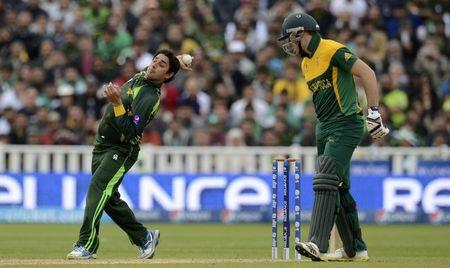 Pakistan's Saeed Ajmal bowls, watched by South Africa's Miller, during the ICC Champions Trophy group B match at Edgbaston cricket ground in Birmingham