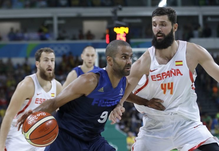 France's Tony Parker (9) drives the ball around Spain's Nikola Mirotic (44) during a men's quarterfinal round basketball game at the 2016 Summer Olympics in Rio de Janeiro, Brazil, Wednesday, Aug. 17, 2016. (AP Photo/Eric Gay)