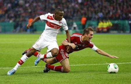 Bayern Munich's Lahm is fouled by VfB Stuttgart's Traore during their German soccer cup (DFB Pokal) final match at the Olympic Stadium in Berlin