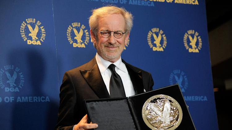 "Steven Spielberg poses backstage with his feature film nomination plaque for ""Lincoln"" at the 65th Annual Directors Guild of America Awards at the Ray Dolby Ballroom on Saturday, Feb. 2, 2013, in Los Angeles. (Photo by Chris Pizzello/Invision/AP)"