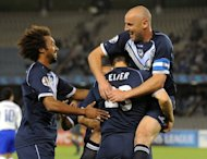 Melbourne Victory's Adrian Leijer (C), Isaka Cernak-Okanya (L) and Kevin Muscat (R) at an AFC Champions League football match in May 2011. The team has appointed Ange Postecoglou as their new coach