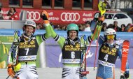 Second-placed Fritz Dopfer of Germany, winner Felix Neureuther of Germany and third-placed Henrik Kristoffersen of Norway (L-R) celebrate after the Alpine Skiing World Cup men's slalom ski race in Kranjska Gora March 9, 2014. REUTERS/Srdjan Zivulovic (SLOVENIA - Tags: SPORT SKIING)