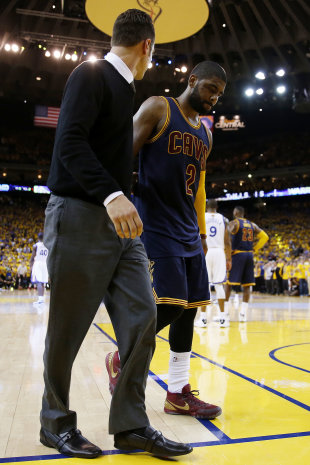 OAKLAND, CA - JUNE 04: Kyrie Irving #2 of the Cleveland Cavaliers leaves the game injured against the Golden State Warriors during Game One of the 2015 NBA Finals at ORACLE Arena on June 4, 2015 in Oakland, California. (Photo by Ezra Shaw/Getty Images)