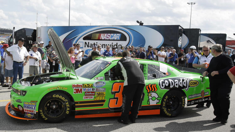 Danica Patrick's crew members push he car back to her garage after she had engine problems in the NASCAR Nationwide Series auto race at Daytona International Speedway, Saturday, Feb. 23, 2013, in Daytona Beach, Fla. (AP Photo/John Raoux)