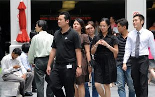 MOM tightens the employment pass criteria to ensure Singaporeans remain at the core of a diverse and globally competitive workforce. (AFP file photo)