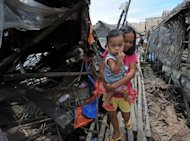 Children in a damaged home in the town of General MacArthur in the Philippines' Samar province after a 7.6 magnitude earthquake on August 31. A moderate earthquake struck the southern Philippines on Monday, just days after a powerful tremor rocked the same region and triggered a tsunami warning, the government said