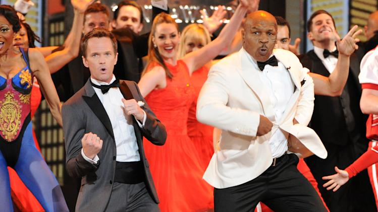 Actor Neil Patrick Harris, left, and Mike Tyson perform on stage at the 67th Annual Tony Awards, on Sunday, June 9, 2013 in New York. (Photo by Evan Agostini/Invision/AP)