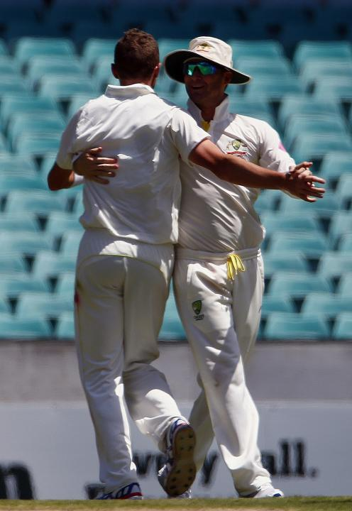 Australia's captain Clarke celebrates with teammate Siddle after dismissing England's Stokes for 47 runs during the second day of the fifth Ashes cricket test at the Sydney cricket ground