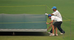 MS Dhoni inspects the wicket at the Kotla Stadium on November 4.