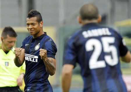 Inter Milan's Fredy Guarin celebrates after scoring a second goal against Parma during their Italian Serie A soccer match in Parma