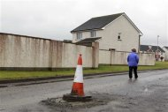 Rhoda Brogan walks around the Glenall housing estate in the village of Borris-in-Ossory, County Laois, Ireland February 13, 2013. REUTERS/Cathal McNaughton