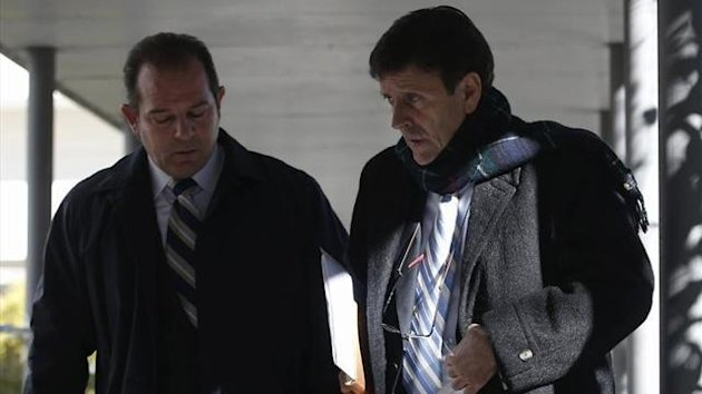Spanish doctor Eufemiano Fuentes (R) leaves a courthouse during the Operation Puerto doping trial in Madrid (Reuters)