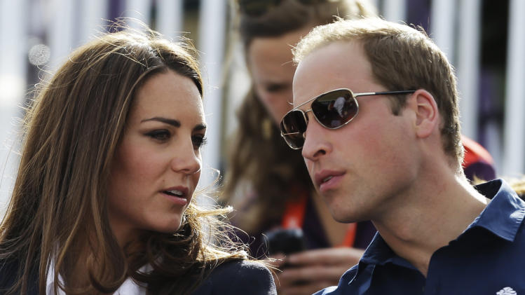 Britain's Catherine, Duchess of Cambridge, and Britain's Prince William, the Duke of Cambridge, watch the equestrian eventing cross country phase at the 2012 Summer Olympics, Monday, July 30, 2012, in London. (AP Photo/David Goldman)