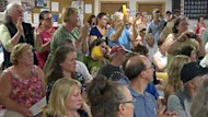 Opponents to shale gas exporation in Norton applaud a speaker during a public meeting on the government's proposed industry reforms in July. An industry group says the province needs to clarify its shale gas rules.