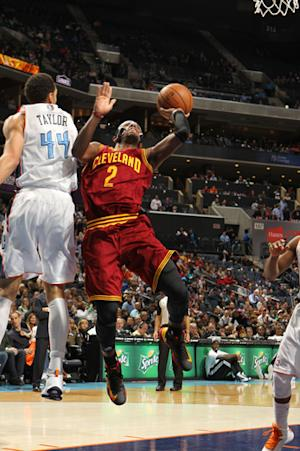 Irving scores 33, lifts Cavs over Bobcats 106-104