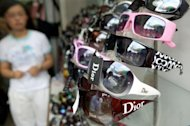 Fake brandname sunglasses are seen in Shanghai 2006. US authorities charged 29 people Friday who were conspiring to illegally import counterfeit luxury fashion goods and deadly drugs worth hundreds of millions of dollars from China and Taiwan