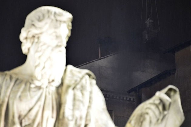 Black smoke rises from the chimney on the roof of the Sistine Chapel meaning that cardinals failed to elect a new pope in the first ballot of their secret conclave on March 12, 2013 at the Vatican