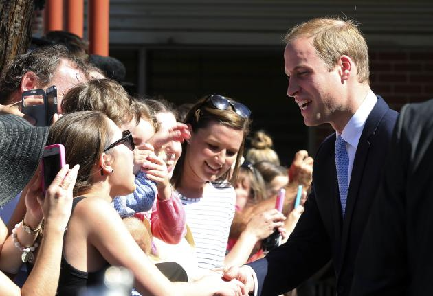 Britain's Prince William greets onlookers during a visit to the Royal Easter Show in Sydney