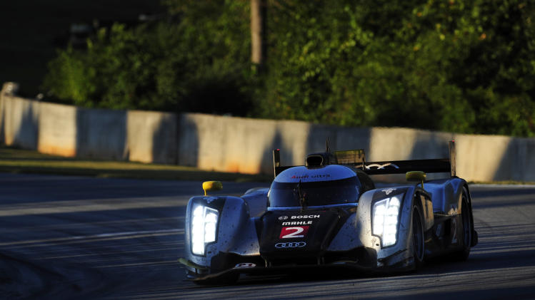 Audi Sport driver Rinaldo Capello, of Italy, goes through a corner during the American Le Mans Series' Petit Le Mans auto race at Road Atlanta, Saturday, Oct. 1, 2011, in Braselton, Ga.  (AP Photo/Rainier Ehrhardt)