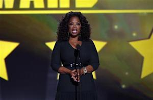 Oprah Winfrey presents the Joel Siegel award at the 19th annual Critics' Choice Movie Awards in Santa Monica