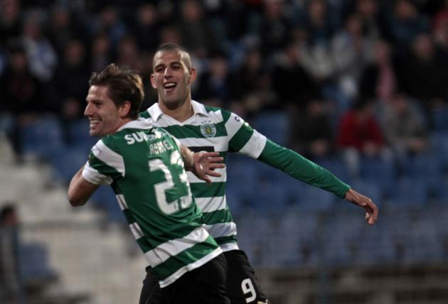 Sporting's Adrien Silva celebrates his goal against Belenenses with teammate Islam Slimani during their Portuguese Premier League soccer match at Restelo stadium
