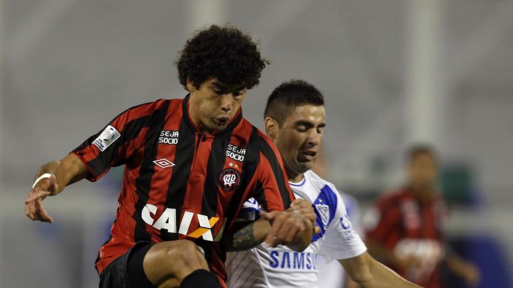 Mendes of Brazil's Atletico Paranaense kicks the ball past Correa of Argentina's Velez Sarsfield during their Copa Libertadores match in Buenos Aires