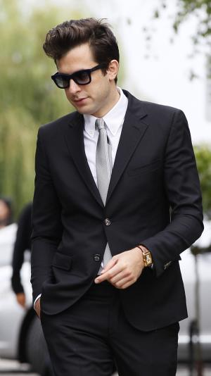 Music producer Mark Ronson leaves  Edgwarebury Cemetery in London, Tuesday July 26, 2011, after attending the funeral of singer Amy Winehouse.  The soul diva, who had battled alcohol and drug addiction, was found dead Saturday at her London home. She was 27. (AP Photo/Kirsty Wigglesworth)