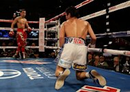 Nonito Donaire of the Philippines (L), pictured after knocking down Jorge Arce of Mexico during their WBO super bantamweight title bout at the Toyota Center in Houston, Texas, on December 15, 2012. Donaire knocked out Arce at the end of the third round, for his 30th win in a row