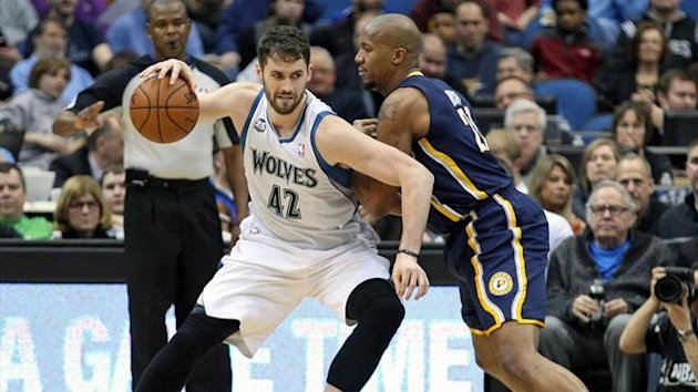 Minnesota Timberwolves forward Kevin Love (42) backs down on Indiana Pacers forward David West (21) during the third quarter at Target Center (Reuters)