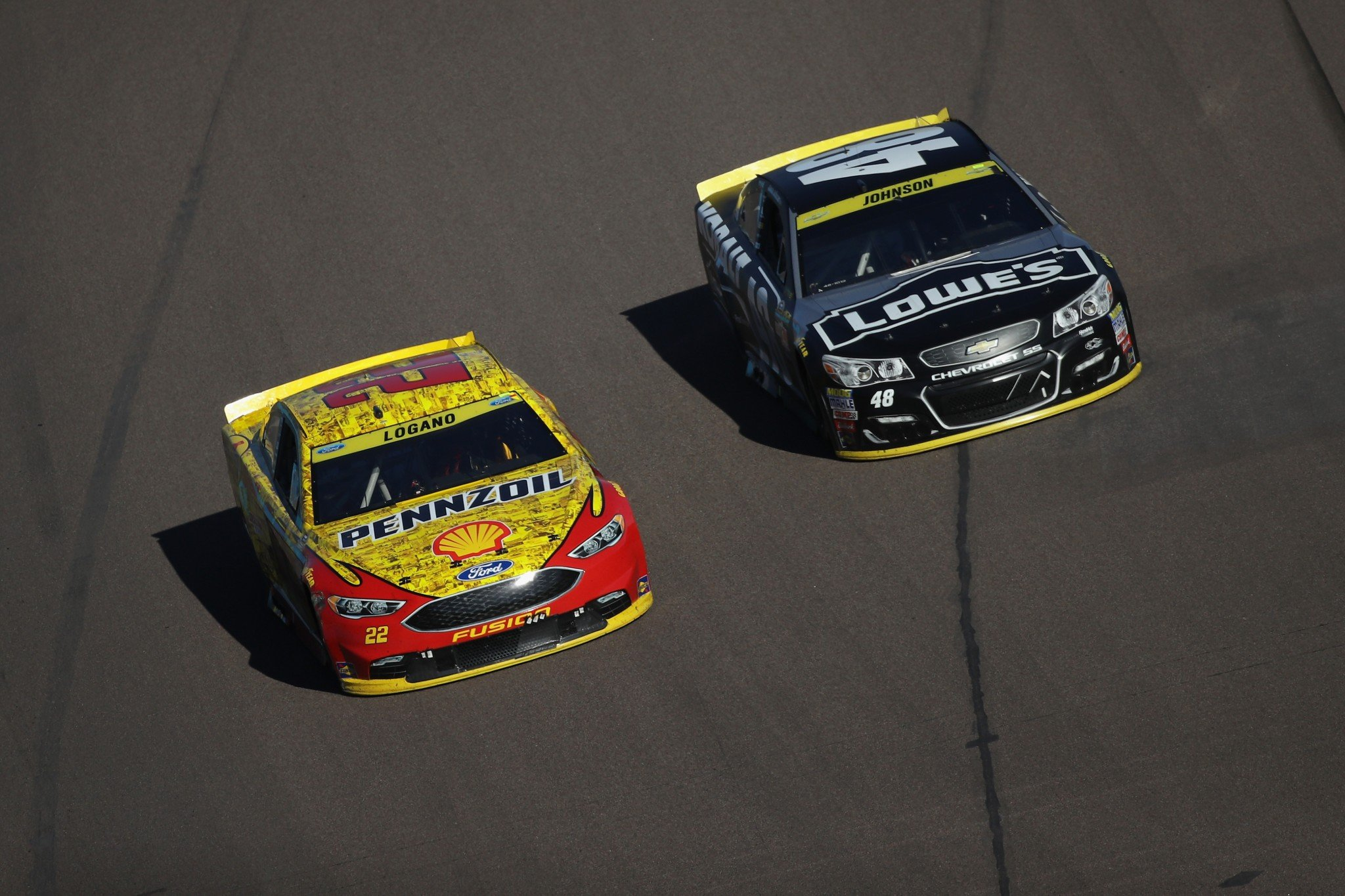Joey Logano leads Jimmie Johnson this week. (Getty)