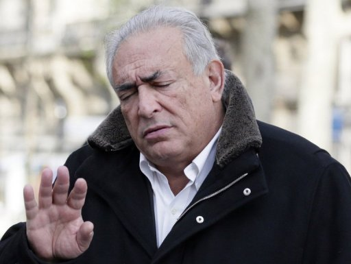 Former International Monetary Fund chief Dominique Strauss-Kahn gestures as he leaves a restaurant in Paris on December 11, 2012. A probe into allegations that Strauss-Kahn procured prostitutes for sex parties will continue after a French court rejected a request for pimping charges against the former IMF chief to be dismissed.