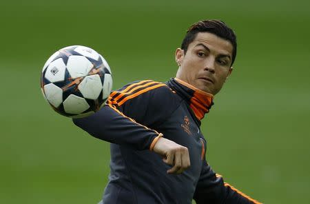 Real Madrid's Cristiano Ronaldo eyes for a ball during a training session in Dortmund