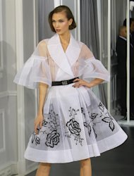 A model wears a creation by British Fashion designer Bill Gaytten as part of his Women's Dior Spring Summer 2012 Haute Couture fashion collection presented in Paris, Monday, Jan. 23, 2012. (AP Photo/ Jacques Brinon)